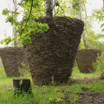 Pots made form from wine cuttings as sculptures in a forest