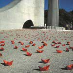 Installing 300 red paper boats at the Afrikaans Taal Monument, Paarl, South Africa.