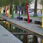 Wrapping trees in different colored fabric as part of the Cape Town Design Capital of the World. Cape Town, South Africa.