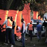 Wrapping of trees in orange fabric as part of a installation for the FIFA Soccer World Cup 2010. Braamfontein, Johannesburg, South Africa.