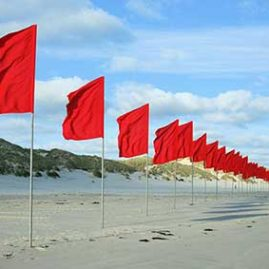 Installing 100 flags 3 meters high by 800 meters long on the beach and dunes at Terschellinge Island in the Netherlands as part of the Oerol Arts Festival.